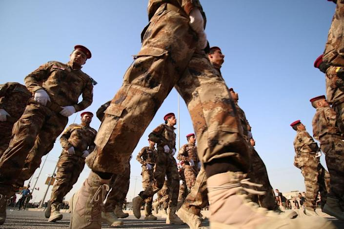 Fighters from the Abbas battalion of the Shiite Popular Mobilisation units march during a military parade in the southern Iraqi city of Basra on September 26, 2015 (AFP Photo/Haidar Mohammed Ali)