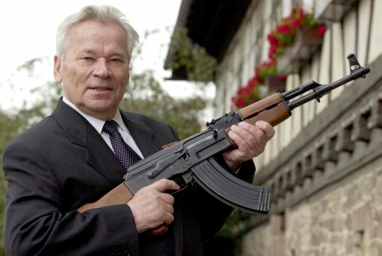 ussian general Mikhail Kalashnikov poses with his famous assault rifle in 2002