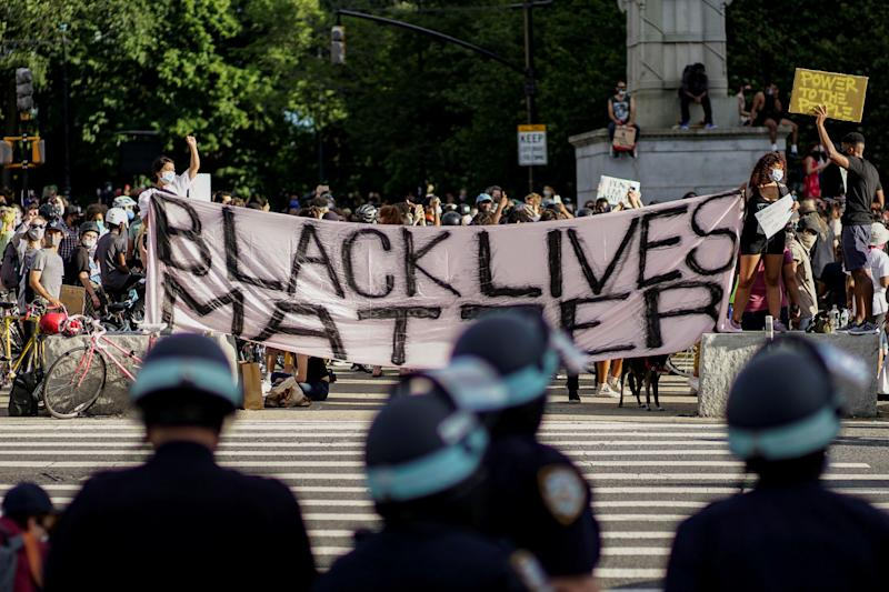Demonstrators hold a Black Lives Matter banner during a protest against racial inequality in the aftermath of the death in Minneapolis police custody of George Floyd, in front of the at Grand Army Plaza in the Brooklyn borough of New York City, New York, U.S. June 7, 2020. REUTERS/Eduardo Munoz TPX IMAGES OF THE DAY