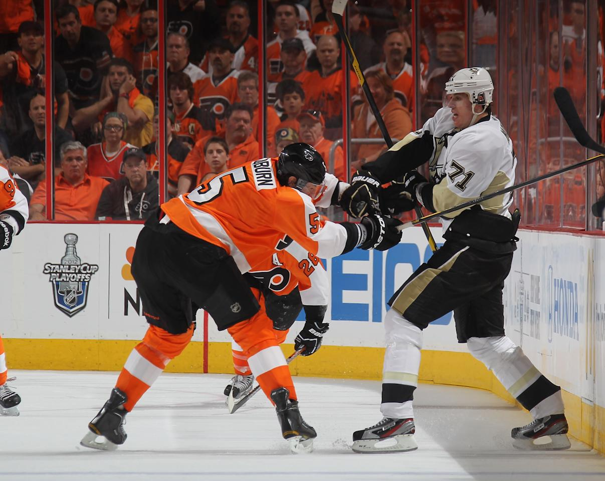 PHILADELPHIA, PA - APRIL 15: Braydon Coburn #5 of the Philadelphia Flyers checks Evgeni Malkin #71 of the Pittsburgh Penguins in Game Three of the Eastern Conference Quarterfinals during the 2012 NHL Stanley Cup Playoffs at Wells Fargo Center on April 15, 2012 in Philadelphia, Pennsylvania. The Flyers defeated the Penguins 8-4. (Photo by Bruce Bennett/Getty Images)