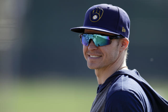 Milwaukee Brewers infielder Brock Holt looks on during spring training baseball Wednesday, Feb. 19, 2020, in Phoenix. Holt and the Brewers finalized a one-year contract Wednesday, a deal that includes a team option for 2021. (AP Photo/Gregory Bull)