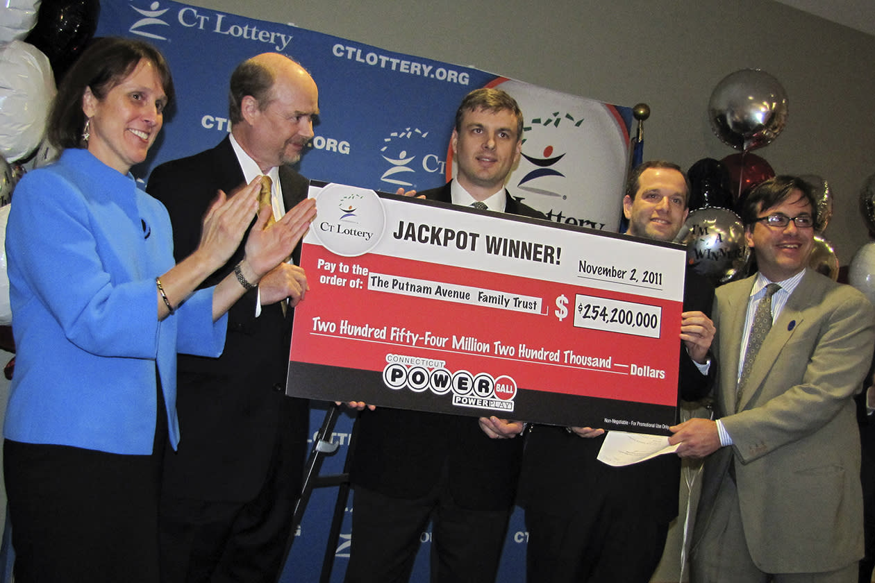<b>$254.2 million</b><br><br>Wealth managers Tim Davidson, second left, Greg Skidmore, center, and Brandon Lacoff, second right, pose Monday, Nov. 28. 2011 with a ceremonial check after the men claimed a $254.2 million Powerball jackpot the won on Nov. 2, in Rocky Hill, Conn. The jackpot was the largest ever won in Connecticut and the 12th biggest in Powerball history. The largest previous lottery jackpot in Connecticut was $59.5 million in June 2005.