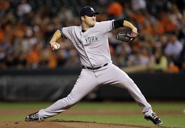 New York Yankees starting pitcher Phil Hughes throws to a Baltimore Orioles batter iwn the first inning of a baseball game, Thursday, Sept. 12, 2013, in Baltimore. (AP Photo/Patrick Semansky)