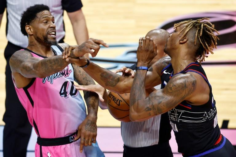 Miami's Udonis Haslem and Philadelphia's Dwight Howard are separated by referee Sean Corbin in a scuffle that saw Haslem ejected from the Heat's 106-94 NBA victory over the 76ers