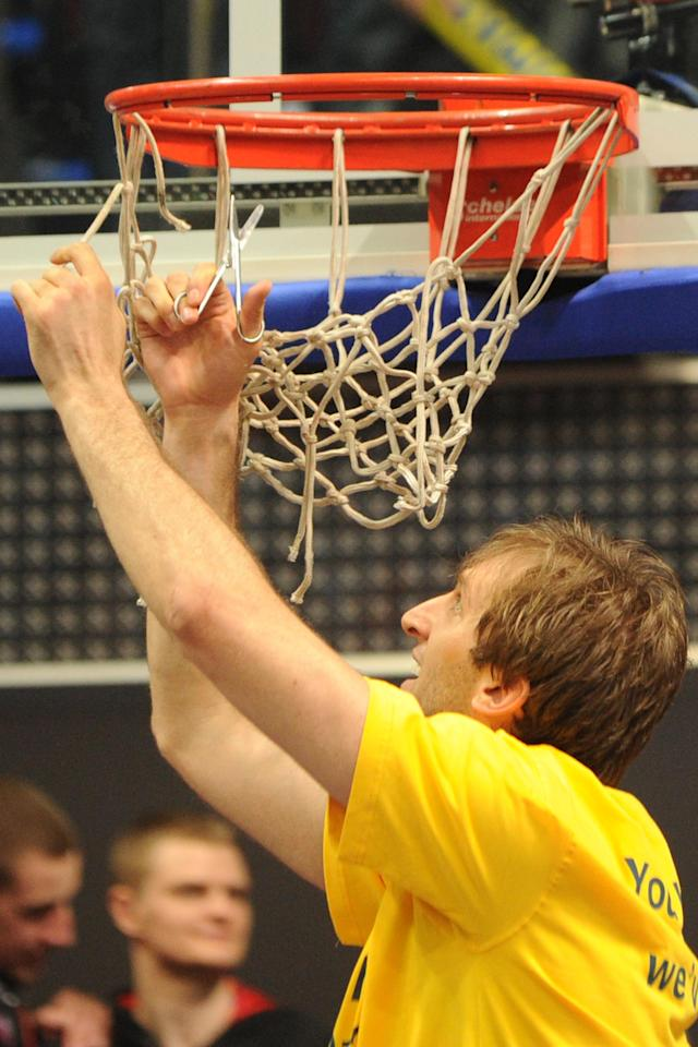 BC Khimki's Zoran Planinic cuts the net as he celebrates winning the Eurocup final basketball match between BC Khimki and Valencia in Khimki, outside Moscow on April 15, 2012. BC Khimki won 77-68. AFP PHOTO / KIRILL KUDRYAVTSEV (Photo credit should read KIRILL KUDRYAVTSEV/AFP/Getty Images)