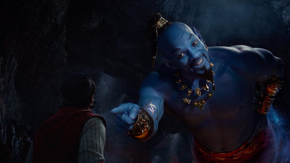 Aladdin (Mena Massoud) meets the larger-than-life blue Genie (Will Smith) in Disney's live-action adaptation ALADDIN, directed by Guy Ritchie. (Disney)