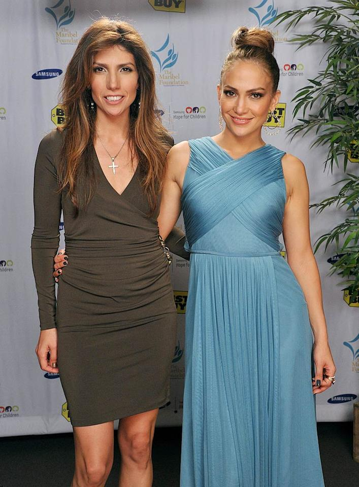 Jennifer Lopez showed up with her younger sister Lynda Lopez at a charity event at a Best Buy store in Los Angeles on Tuesday. Though she rarely makes public appearances with J.Lo, Lynda actually has had a pretty successful media career, which included stints as a local TV news anchor and radio DJ in New York City. Who knew?! (10/25/2011)