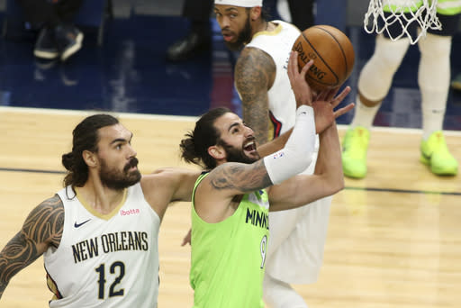 Minnesota Timberwolves guard Ricky Rubio (9) shoots against New Orleans Pelicans center Steven Adams (12) in the first quarter during an NBA basketball game, Saturday, Jan. 23, 2021, in Minneapolis. (AP Photo/Andy Clayton-King)