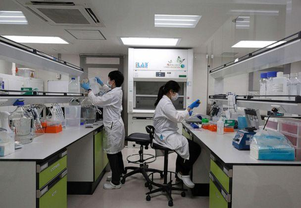 PHOTO: Thai medical technologists work inside a laboratory of the vaccine production process at the Siam Bioscience vaccine production plant, in Nonthaburi province, on the outskirts of Bangkok, Thailand, June 1, 2020. (Narong Sangnak/EPA via Shutterstock)