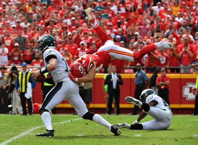<p>Defensive back Daniel Sorensen #49 of the Kansas City Chiefs leaps to make a sack attempt on quarterback Carson Wentz #11 of the Philadelphia Eagles during the fourth quarter of the game at Arrowhead Stadium on September 17, 2017 in Kansas City, Missouri. ( Photo by Peter Aiken/Getty Images) </p>