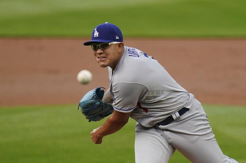 Los Angeles Dodgers starting pitcher Julio Urias throws against the Seattle Mariners in a baseball game Wednesday, Aug. 19, 2020, in Seattle. (AP Photo/Elaine Thompson)