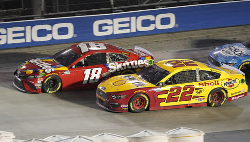 Kyle Busch (18) and Joey Logano (22) drive out of Turn 4 during the NASCAR Cup Series auto race Saturday, Sept. 19, 2020, in Bristol, Tenn. (AP Photo/Steve Helber)