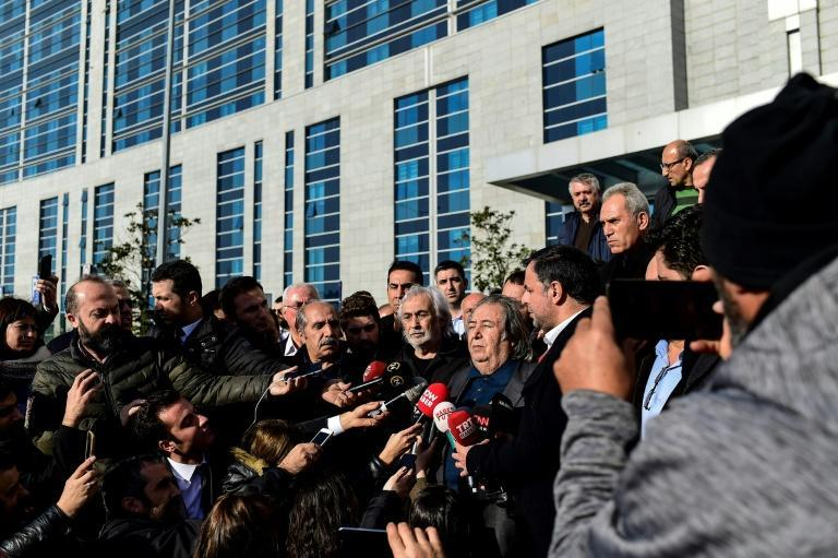 Gezen answers journalists' questions as he leaves a courthouse in Istanbul on December 24, 2018, after a hearing in the case against him for 'insulting' statements against Erdogan