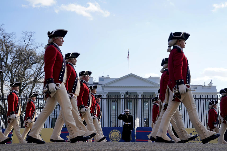 WASHINGTON, DC - JANUARY 20: Members of a marching band walk the abbreviated parade route in front of the White House following the inauguration of U.S. President Joe Biden on January 20, 2021 in Washington, DC. Biden became the 46th president of the United States earlier today during the ceremony at the U.S. Capitol. (Photo by Drew Angerer/Getty Images)