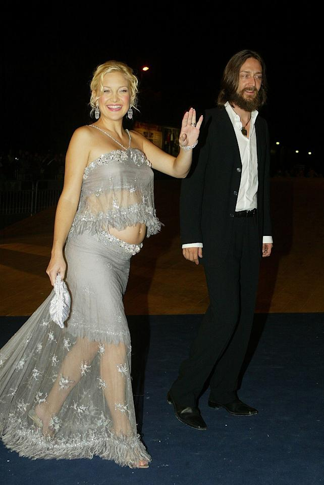 "<p>In 2003, Kate Hudson bared her budding bump in a sheer feathered crop top and matching floor-skimming skirt at the Venice Film Festival premiere of ""The Divorce<em>.</em>""<em> (Photo: Getty)</em> </p>"