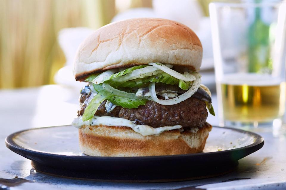 """These are some seriously juicy lamb burgers, topped with a tangy aioli and crunchy fennel slaw. <a href=""""https://www.epicurious.com/recipes/food/views/lamb-burgers-with-lemon-caper-aioli-and-fennel-slaw?mbid=synd_yahoo_rss"""" rel=""""nofollow noopener"""" target=""""_blank"""" data-ylk=""""slk:See recipe."""" class=""""link rapid-noclick-resp"""">See recipe.</a>"""