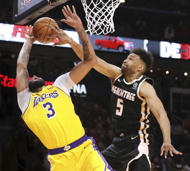 Atlanta Hawks forward Jabari Parker (5) blocks a shot by Los Angeles Lakers forward Anthony Davis (3) during the second half of an NBA basketball game Sunday, Dec. 15, 2019, in Atlanta. The block was called a foul but was overturned on a coach's challenge. Curtis Compton/ccompton@ajc.com/Atlanta Journal-Constitution via AP)