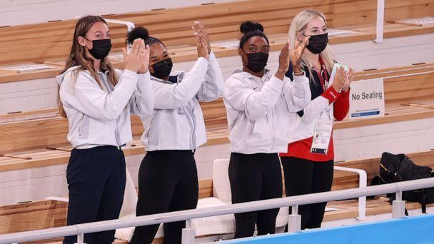 PHOTO: TOKYO, JAPAN - JULY 29: (L-R) Riley McCusker, Jordan Chiles, Simone Biles, and Mykayla Skinner of Team United States,cheer after Sunisa Lee won the gold medal in the Women's All-Around Final on day six of the Tokyo 2020 Olympic Games. (Laurence Griffiths/Getty Images)