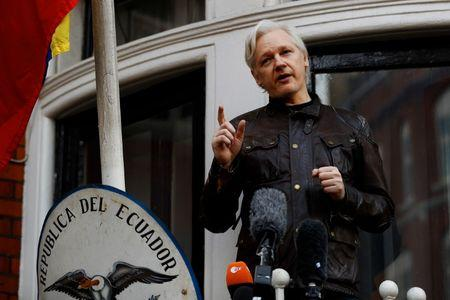 WikiLeaks founder Julian Assange is seen on the balcony of the Ecuadorian Embassy in London, Britain, May 19, 2017. REUTERS/Peter Nicholls