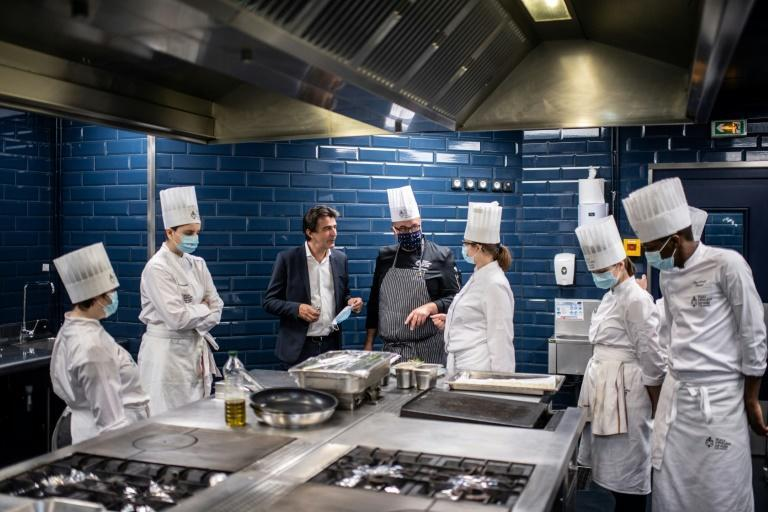 French Michelin star chef Yannick Alleno (3rd L) wants to reinvent fine dining for a post-Covid age