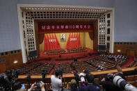 Journalists film Chinese President Xi Jinping as he delivers a speech at an event commemorating the 110th anniversary of Xinhai Revolution at the Great Hall of the People in Beijing, Saturday, Oct. 9, 2021. (AP Photo/Andy Wong)