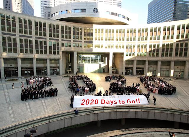 Particapants gather outside the Tokyo Metropolitan Assembly building in Tokyo, on January 12, 2015, to collectively form the number '2020' for the countdown ceremony of the Tokyo 2020 Olympic Games (AFP Photo/Yoshikazu Tsuno)