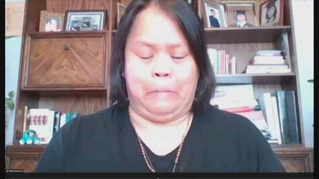 Candida Macarine's daughter Gilda holds back tears during an online news conference Monday.