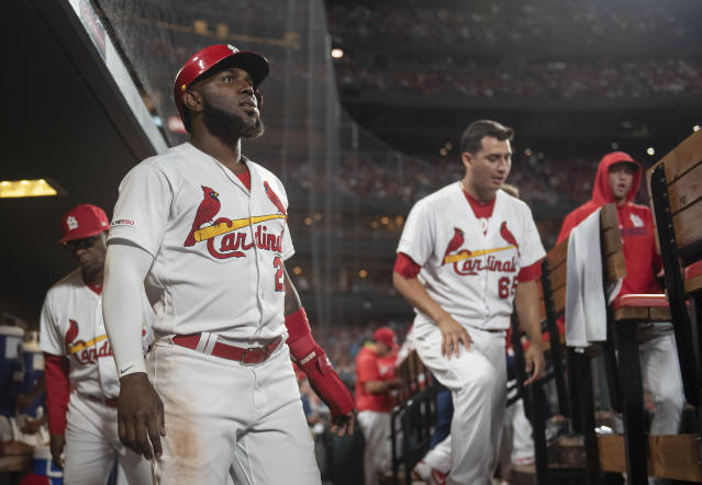 St. Louis Cardinals' Marcell Ozuna, front left, celebrates in the dugout after scoring during the seventh inning of a baseball game against the Los Angeles Angels, Friday, June 21, 2019, in St. Louis. (AP Photo/L.G. Patterson)
