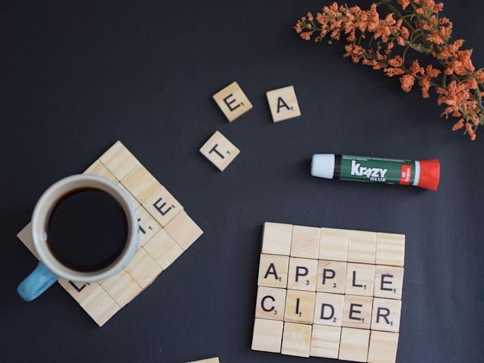 """<p>Dad will smile every time he sits down at his desk with a cup of coffee or tea. With these Scrabble tile coasters, you can write out anything from a sweet """"I Love You"""" to his name to <a href=""""https://www.womansday.com/relationships/family-friends/a32460989/fathers-day-puns/"""" rel=""""nofollow noopener"""" target=""""_blank"""" data-ylk=""""slk:a funny pun"""" class=""""link rapid-noclick-resp"""">a funny pun</a>. The possibilities are endless. </p><p><em>Get the tutorial at <a href=""""https://www.mintcandydesigns.com/2020/10/diy-scrabble-tile-coasters-with-krazy-glue/"""" rel=""""nofollow noopener"""" target=""""_blank"""" data-ylk=""""slk:Mint Candy Designs"""" class=""""link rapid-noclick-resp"""">Mint Candy Designs</a>. </em><br></p><p><a class=""""link rapid-noclick-resp"""" href=""""https://www.amazon.com/Wood-Scrabble-Tiles-Letters-Crafts/dp/B07D52MP4N/ref=sr_1_5?tag=syn-yahoo-20&ascsubtag=%5Bartid%7C10070.g.32697573%5Bsrc%7Cyahoo-us"""" rel=""""nofollow noopener"""" target=""""_blank"""" data-ylk=""""slk:SHOP SCRABBLE TILES"""">SHOP SCRABBLE TILES</a></p>"""