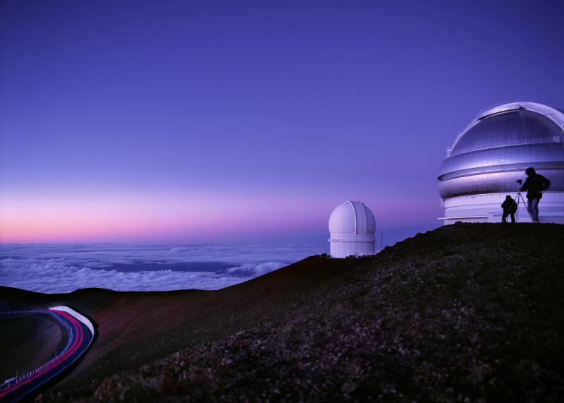 See snow-capped mountains from the Mauna Kea observatory. (Photo: Getty)