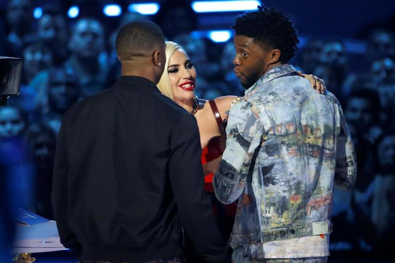 Singer Lady Gaga presents actors Chadwick Boseman (R) and Michael B. Jordan with the Best Movie award for Black Panther (REUTERS)