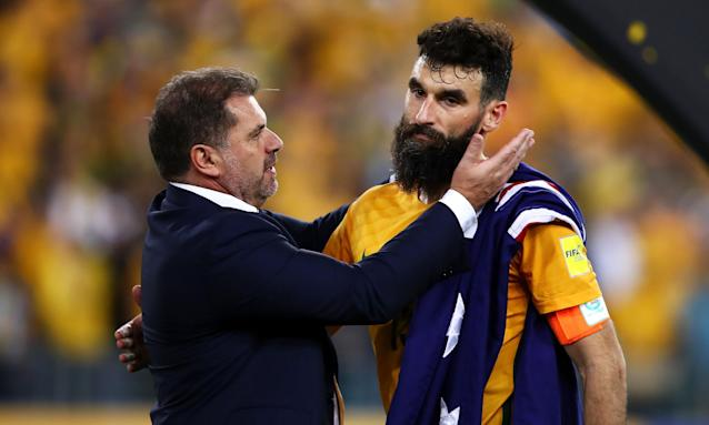 Ange Postecoglou congratulates captain Mile Jedinak after the Socceroos beat Honduras 3-1.