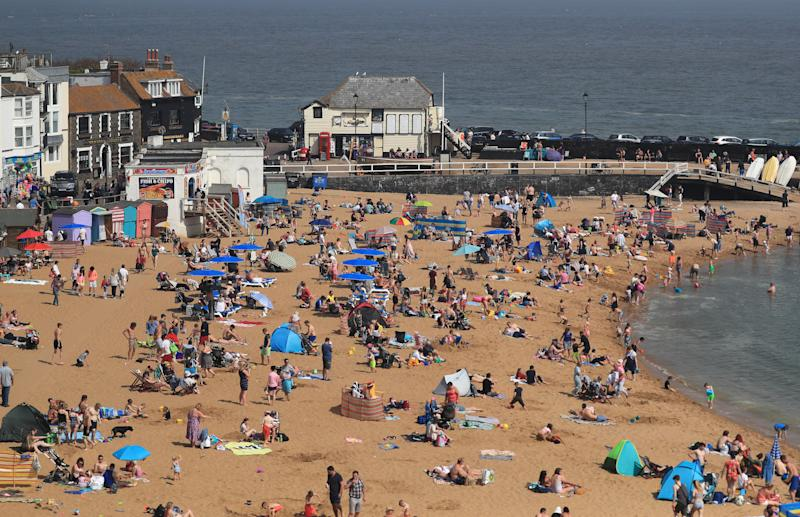 People enjoy the bank holiday sunshine on the beach in Broadstairs, Kent, as the UK continues to enjoy the warm Easter weather.