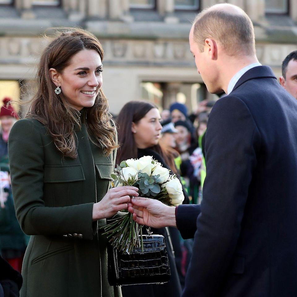<p>Moments before the royal couple left City Hall in Bradford, the Duke of Cambridge took the chance to give his wife a white rose, January 2020. </p>