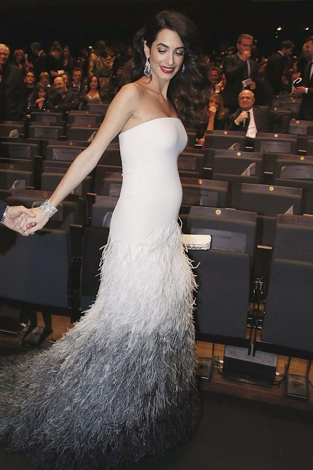 """<p>Amal wore Atelier Versace to accompany George to the 42nd César Awards. There he was deemed """"the most charismatic actor of his generation,"""" and she <a rel=""""nofollow"""" href=""""http://people.com/babies/amal-pregnant-george-clooney-cesar-awards?mbid=synd_yahoostyle"""">told reporters</a> (in French), """"It is a great honor for us to be here. It's the first time we're in Paris together so it's a bit of a romantic weekend for us.""""</p>"""