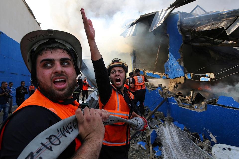 A Palestinian firefighter reacts as he participates in efforts to put out a fire at a sponge factory after it was hit by Israeli artillery shellsREUTERS