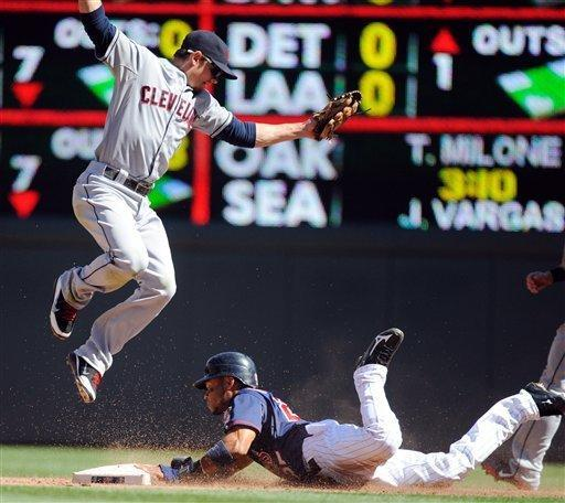 Minnesota Twins' Ben Revere, right, steals second as Cleveland Indians shortstop Brent Lillibridge, left, jumps to catch the throw in the fourth inning of their baseball game in Minneapolis, Sunday, Sept. 9, 2012. (AP Photo/Craig Lassig)