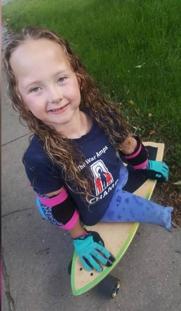 Milania Keeler had her skateboard which she uses as a mobility device stolen from the Lakewood bike park on Saturday afternoon. Now her family is trying to get the board back as it carries with it immense sentimental value.  (Submitted by Desiree Keeler - image credit)