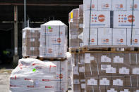 """Pallets of aid wait to be loaded at Toussaint Louverture International Airport, Saturday, Aug. 28, 2021, in Port-au-Prince, Haiti. The VMM-266, """"Fighting Griffins,"""" from Marine Corps Air Station New River, from Jacksonville, N.C., are flying in support of Joint Task Force Haiti after a 7.2 magnitude earthquake on Aug. 22, caused heavy damage to the country. (AP Photo/Alex Brandon)"""