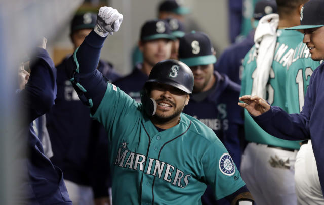 Seattle Mariners' Omar Narvaez celebrates his home run against the Houston Astros during the 10th inning of a baseball game Thursday, June 6, 2019, in Seattle. (AP Photo/Elaine Thompson)
