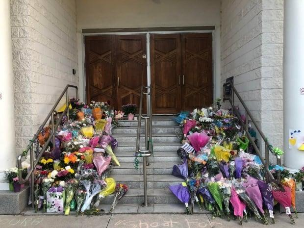 Flowers lie on the steps of the London Islamic Centre in an outpouring of support shown for the city's Muslim community in the wake of Sunday's hit and run attack that killed four members of the Afzaal family. (Andrew Lupton/CBC - image credit)