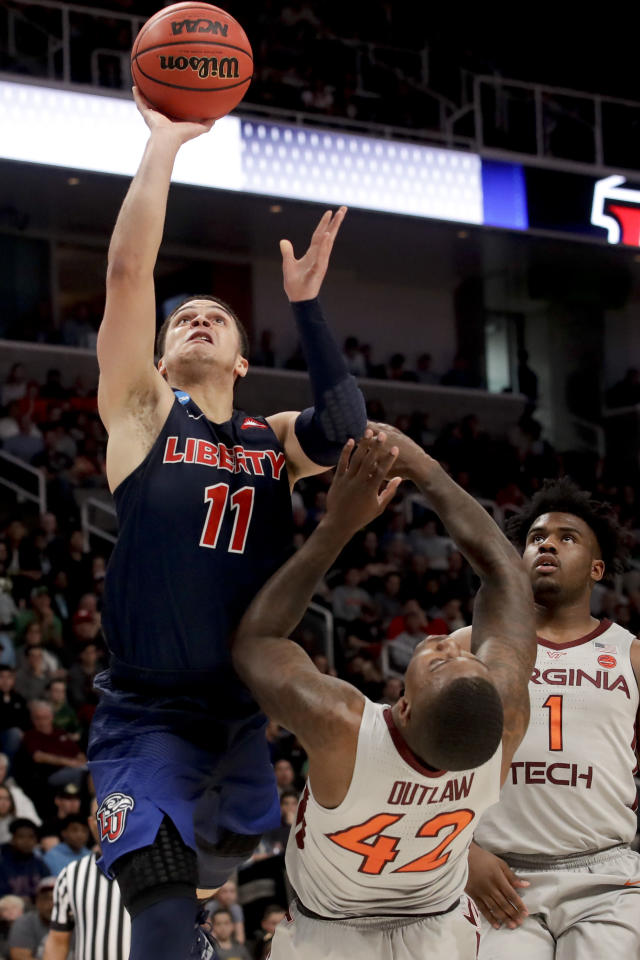 Liberty guard Georgie Pacheco-Ortiz (11) shoots over Virginia Tech guard Ty Outlaw (42) during the first half of a second-round game in the NCAA men's college basketball tournament Sunday, March 24, 2019, in San Jose, Calif. (AP Photo/Jeff Chiu)