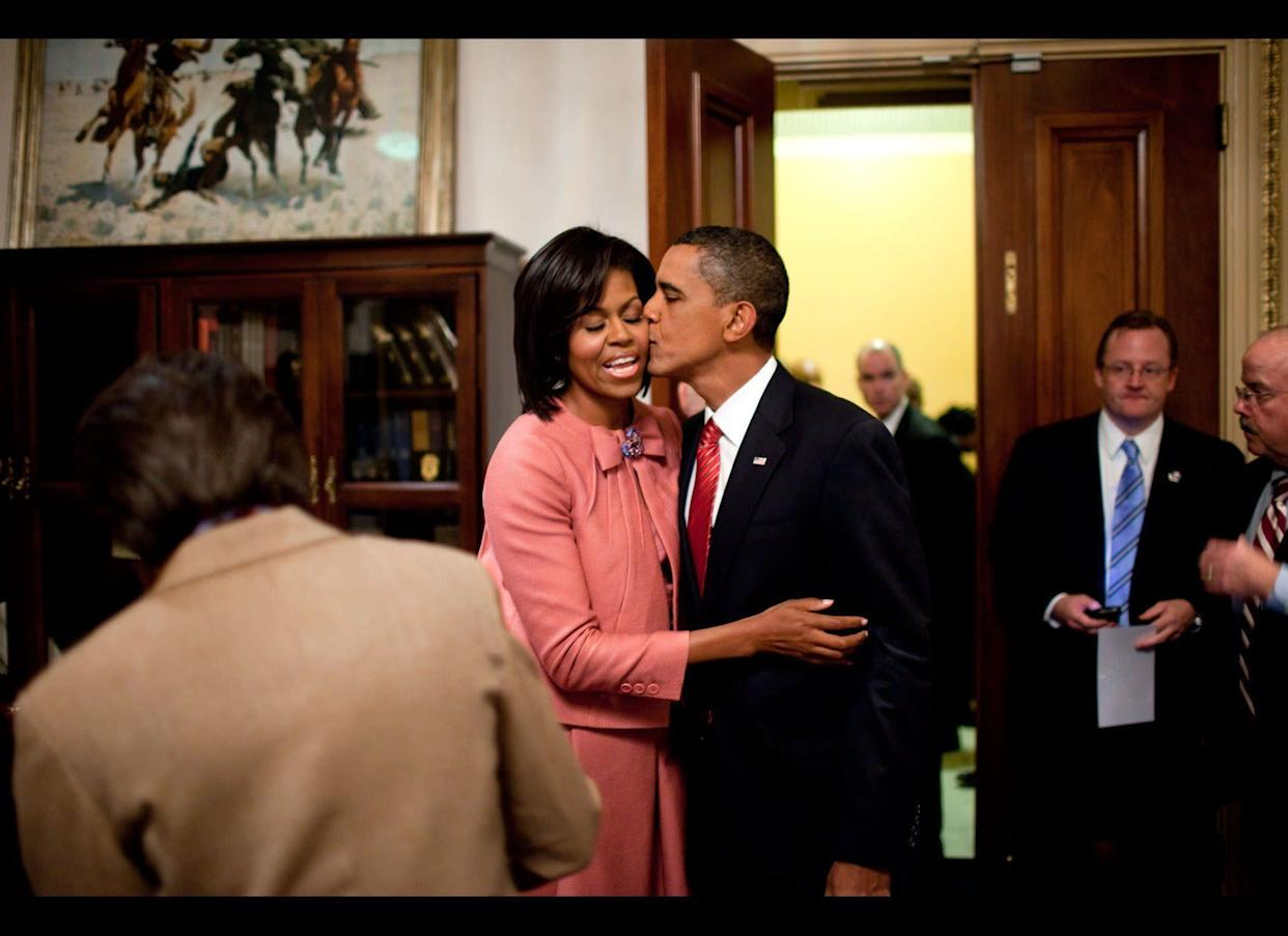 President Barack Obama kisses First Lady Michelle Obama after speaking about health care at a joint session of Congress, Sept. 9, 2009.
