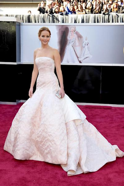 FILE - This Feb. 24, 2013 file photo shows actress Jennifer Lawrence at the 85th Academy Awards at the Dolby Theatre in Los Angeles. Prom season provides many girls a chance to have their moment in the spotlight. It's likely that this year's parade of fashions will include a few celebrity lookalikes. (Photo by John Shearer/Invision/AP, file)