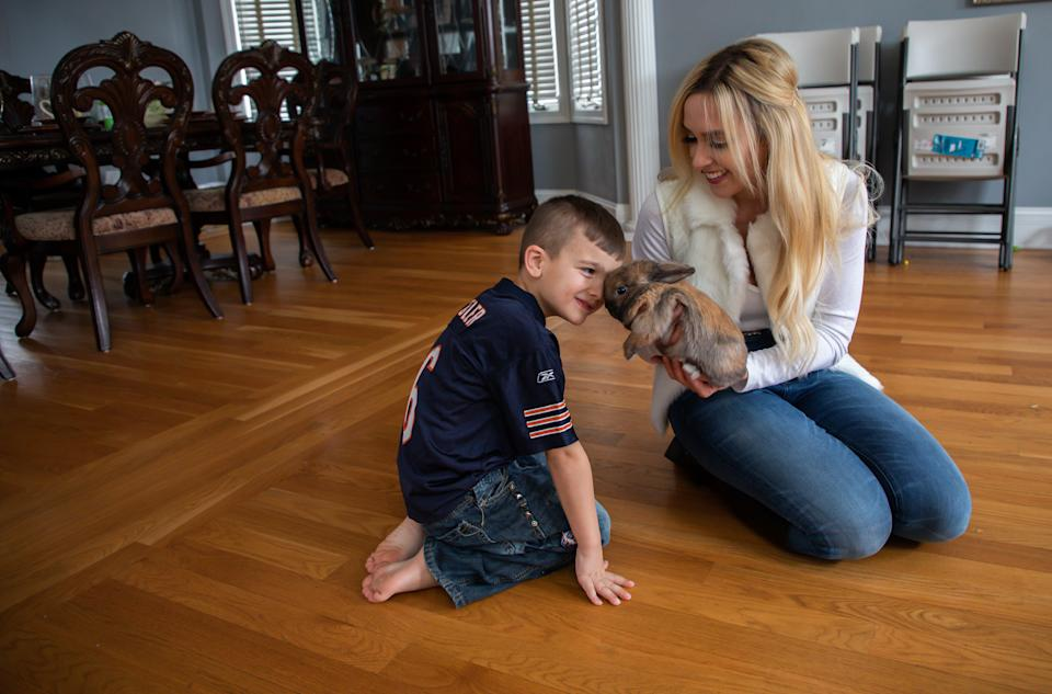 Daniel Rafati, 5, and his mother, Lisa Wilkie, play with their pet rabbit Baby Bun Bun at home in Frankfort on Jan. 28, 2019. (Zbigniew Bzdak/Chicago Tribune/Tribune News Service via Getty Images)