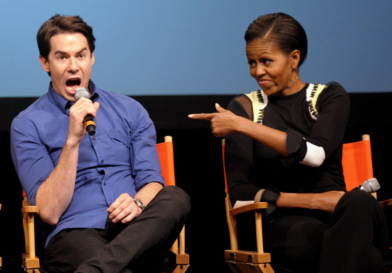 """First lady Michelle Obama points toward Nickelodeon's iCarly cast member Jerry Trainor as they answer student's questions during a special screening of """"iMeet The First Lady"""" episode of the show, Friday, Jan. 13, 2012, at Hayfield Secondary School in Fairfax, Va. (AP Photo/Cliff Owen)"""