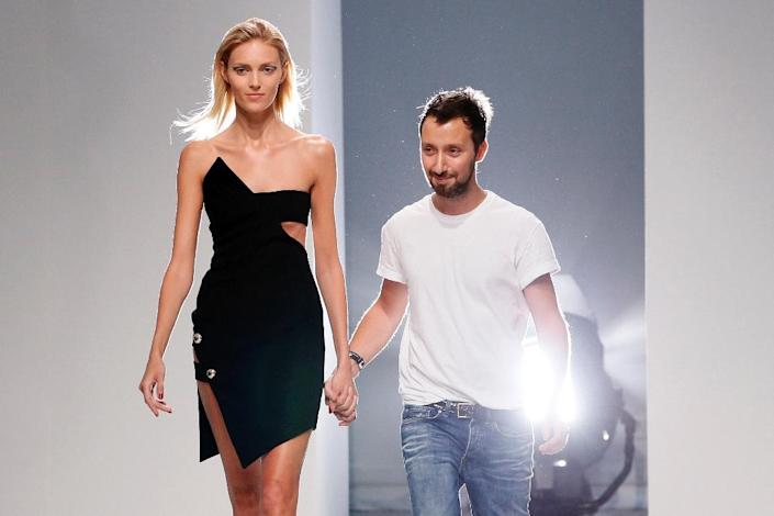 Belgian fashion designer Anthony Vaccarello acknowledges the public with Polish model Anja Rubik (L) at the end of his 2014 Spring/Summer ready-to-wear collection fashion show, on September 24, 2013 in Paris (AFP Photo/Patrick Kovarik)