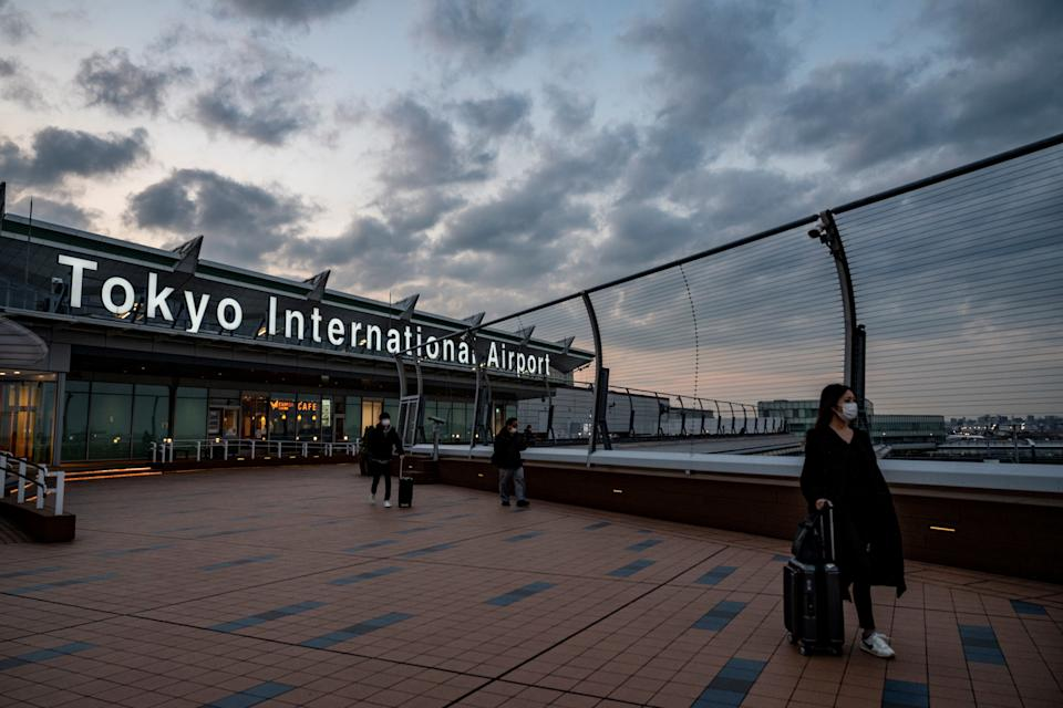 Travellers visit the observation deck at Tokyo's Haneda airport on December 27, 2020, after the government announced more restrictions on travel due to the rise of COVID-19 coronavirus infections across the country. (Photo by Philip FONG / AFP) (Photo by PHILIP FONG/AFP via Getty Images)