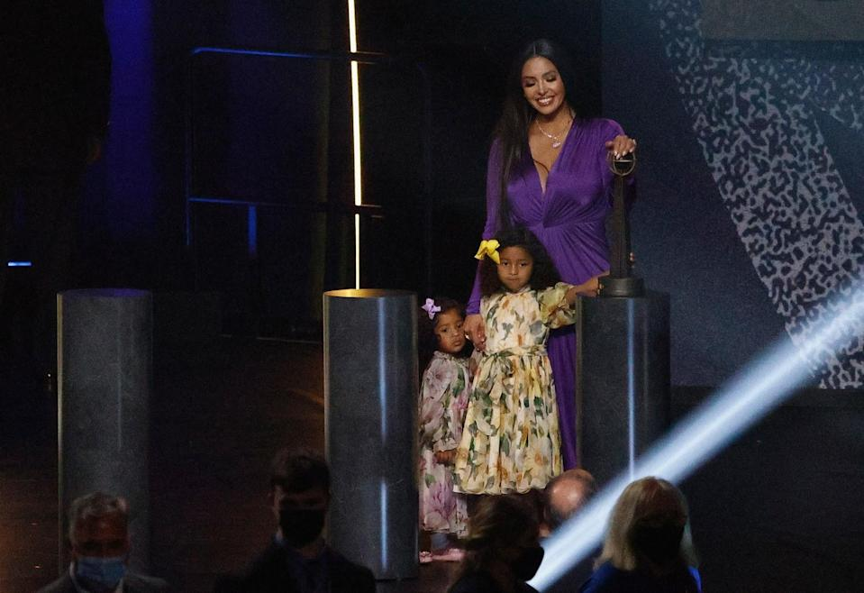 Vanessa Bryant stands with daughters Capri and Bianka at the conclusion of the Hall of Fame induction ceremony.
