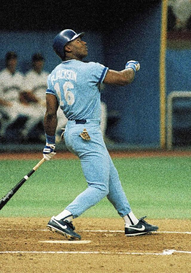 FILE - In this Sept. 21, 1987, file photo, Kansas City Royals' Bo Jackson flies out during the third inning of a baseball game against the Seattle Mariners at the Kingdome in Seattle, Sept. 21, 1987. Florida State's Jameis Winston will become the sixth Heisman winner to play college baseball after winning the award and the first since Bo Jackson in 1986. Winston is the Seminoles' closer, will DH and play outfield. (AP Photo/Gary Stewart, File)